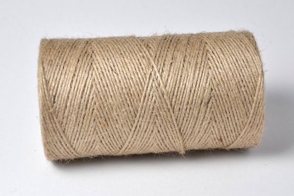 natural coloured un dyed spool of jute twine navy blue braid